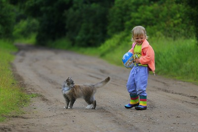 Youngster with cat